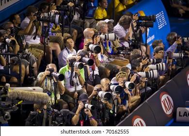 MELBOURNE, AUSTRALIA - JANUARY 30: Australian Open Men's Final, some of the photographers shooting Andy Murray(GBR)[5] get beaten by Novak Djokovic(SRB)[3] on January 30, 2011 in Melbourne, Australia
