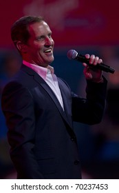 MELBOURNE, AUSTRALIA - JANUARY 30: The Boy From Oz lead, Todd McKenney sings the national anthem at the Australian Open Mens Final, on January 30, 2011 in Melbourne, Australia