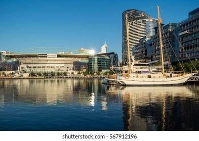 Melbourne, Australia - January 6, 2017: view of Etihad Stadium at Docklands, with boats and bollards in the foreground. Etihad Stadium is mainly used to play AFL Australian rules football.