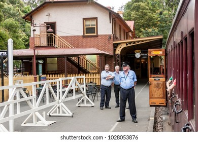 Melbourne, Australia - January 7, 2009: Puffing Billy is historical narrow railway in the Dandenong Ranges near Melbourne. Station master is waiting to departure steam train.
