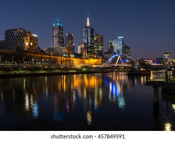 Melbourne, Australia - July 16, 2016: View across the Yarra River towards Flinders Street Station and the Melbourne skyline from the Southbank area.
