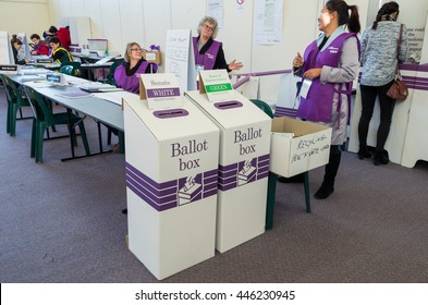 Melbourne, Australia - July 2, 2016: ballot boxes and Australian Electoral Commission staff inside a polling place at Mullauna College, MItcham in the electorate of Deakin on federal election day.