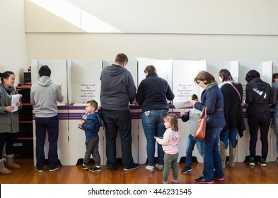 Melbourne, Australia - July 2, 2016: voters filling in their ballot papers in the Mullauna College polling place in Deakin on federal election day.
