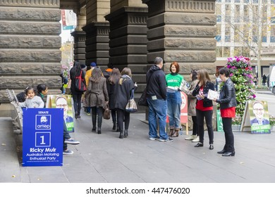 Melbourne, Australia - July 2, 2016: View of electors going to vote for federal election on the polling day while volunteers handing out pamphlets at Melbourne Town Hall.