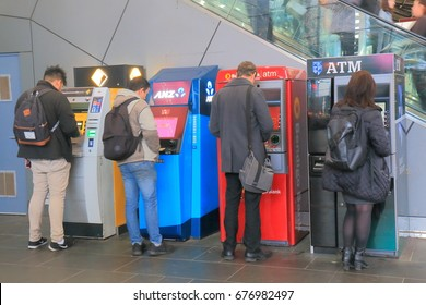 MELBOURNE AUSTRALIA - JULY 2, 2017: Unidentified people use ATM in Melbourne.
