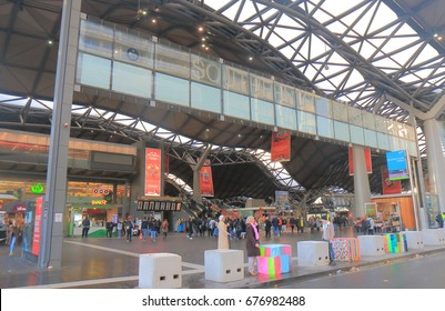 MELBOURNE AUSTRALIA - JULY 3, 2017: Unidentified people travel at Southern Cross Station. Southern Cross Station is the most important rail terminal and public transport interchange in Victoria