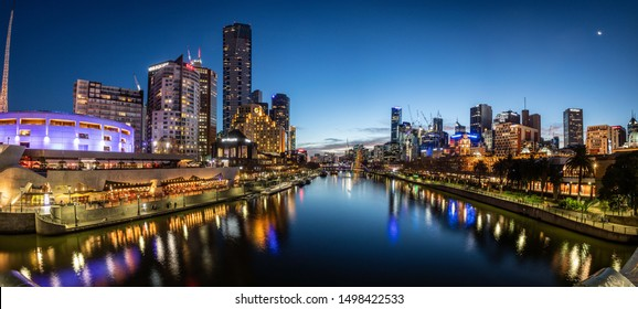 MELBOURNE, AUSTRALIA - JULY 6th, 2019; The Melbourne skyline shot from the Princes bridge in the center of Melbourne. Melbourne is home of the parliament of Victoria.