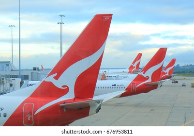 MELBOURNE AUSTRALIA - JULY 8, 2017: Qantas airplanes wait for departure at Melbourne Airport.