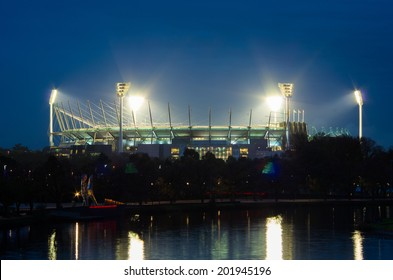 MELBOURNE, AUSTRALIA - JUNE 1, 2014: the Melbourne Cricket Ground or MCG in Melbourne Australia, floodlit for a twilight match of Australian Rules Football.