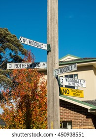 Melbourne, Australia - June 13, 2016: street signs on a power pole at an intersection in suburban Mitcham in Melbourne's eastern suburbs.