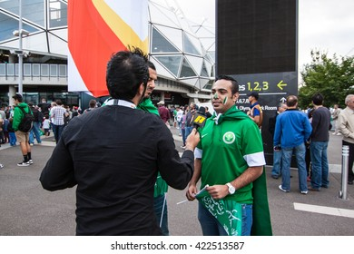 Melbourne, Australia - June 18, 2015 - AFC Asian Cup 2015 Australia - the fans of Saudi Arabia gave the interview to the reporter before game between Uzbekistan VS Saudi Arabia