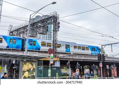 MELBOURNE, AUSTRALIA - JUNE 5, 2014: Metro Trains in Melbourne. It travels over 30 million Km and service more than 228 million customers a year and carries over 415,000 passengers each weekday.