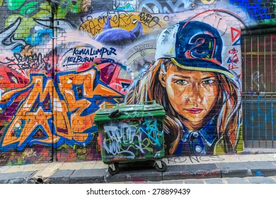 MELBOURNE, AUSTRALIA - MAR 19: Girl Graffiti at Hosier Lane on Mar 19, 2015 in Melbourne. It's one of the tourist attraction which is the ever-changing graffiti on the walls of Hosier Lane.