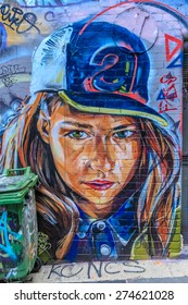 MELBOURNE, AUSTRALIA - MAR 19: Graffiti at Hosier Lane on Mar 19, 2015 in Melbourne. It's one of the tourist attraction which is the ever-changing graffiti on the walls of Hosier Lane.