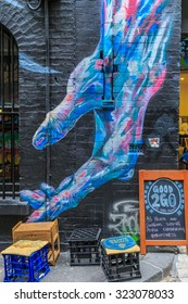 MELBOURNE, AUSTRALIA - MAR 19: Hand Graffiti at Hosier Lane on Mar 19, 2015 in Melbourne. It's one of the tourist attraction which is the ever-changing graffiti on the walls of Hosier Lane.