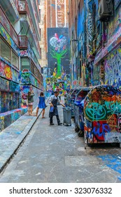 MELBOURNE, AUSTRALIA - MAR 19: Tourists visit Hosier Lane on Mar 19, 2015 in Melbourne. It's one of the tourist attraction which is the ever-changing graffiti on the walls of Hosier Lane.
