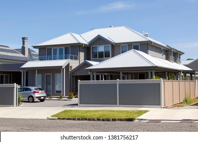 Melbourne, Australia: March 07, 2019: Modern large, detached house in the residential suburb of Williamstown. An individually designed house with off road parking and blue sky background