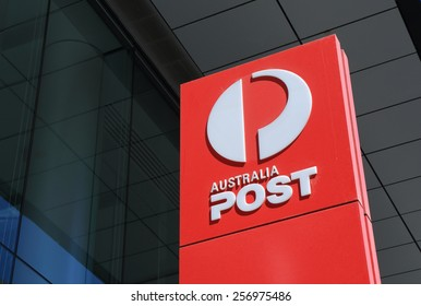 MELBOURNE AUSTRALIA - MARCH 1, 2015: Australia Post logo in Melbourne - Australia Post provides postal services in Australia and its overseas territories and owned by Australian Government