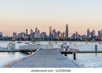 Melbourne, Australia - March 10, 2018: Melbourne city skyline seen from St Kilda Pier at sunrise, in Melbourne, Australia.