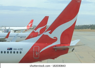 MELBOURNE AUSTRALIA - MARCH 14, 2014: Qantas airplanes wait for departure at Melbourne Airport - Melbourne Airport is the primary airport serving the city of Melbourne and hub for Qantas airlines
