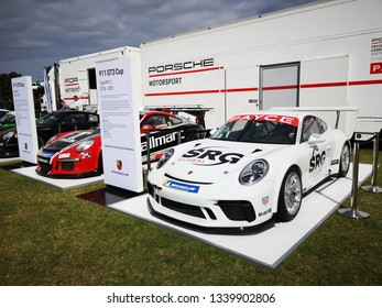 Melbourne, Australia: March 15, 2019: Porsche 911 GT3 racecar on display at a motor show in Melbourne. Celebrating fifteen years of the Carrera Cup Australia. The car is white with sponsorship logos.