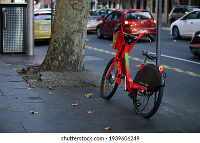 Melbourne, Australia - March 17, 2021:  A Gig worker's broken electric bike, abandoned in a street in Melbourne, Australia.  Flat tyres and a broken chain.