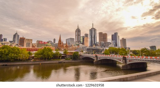 Melbourne, Australia. March 2018 - Melbourne City skyline in the early morning with reflections on the Yarra River. Photo taken on the weekend of the Australian Formula 1 Grand Prix.