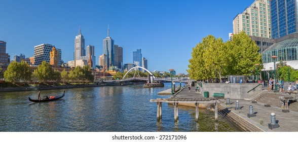 MELBOURNE, AUSTRALIA - MARCH 21, 2015: Panoramic view of the city from Southbank and a romantic ride in a gondola with the gondolier, on beautiful sunny afternoon.