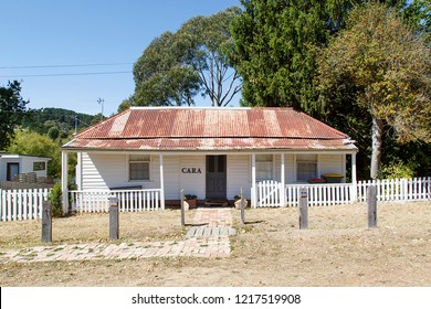 Melbourne, Australia: March 23, 2018: A typical detached double fronted bungalow home with a red corrugated roof, white picket fence and verandah in Daylesford - Australia.