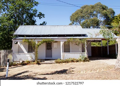 Melbourne, Australia: March 23, 2018: A typical detached double fronted bungalow home with a corrugated roof, white picket fence and verandah in Daylesford - Australia.
