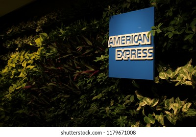MELBOURNE, AUSTRALIA – MARCH 26 2018: American Express logo on display in the new AMEX Lounge at Melbourne Airport. A green living wall greets guests at the entrance.