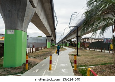 Melbourne, Australia - March 3, 2019: a bike path running underneath the new elevated railway line in Murrumbeena, near Murrumbeena Railway Station.