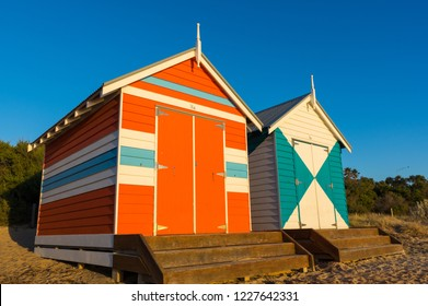 Melbourne, Australia - March 31, 2018: Colourful bathing boxes at Brighton Beach, a popular inner city beach. There are 82 bathing boxes at Brighton Beach.