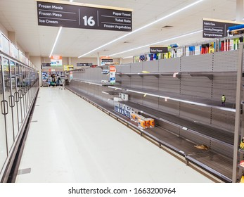 Melbourne, Australia - March 4th 2020: Panicked shoppers buy staples such as canned food, rice, milk and toilet paper. They live in fear of Corona Virus shortening stock supply from China.