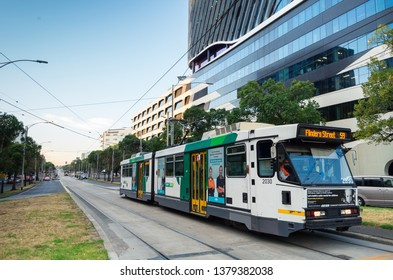Melbourne, Australia - March 7, 2019: trams travelling along Flemington Road bisecting Parkville and North Melbourne.