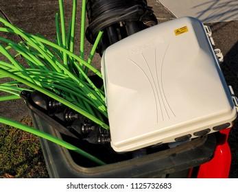 Melbourne, Australia - May 14, 2018: Rubbish bin full of NBN fibre optic cables and accessories
