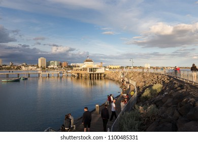Melbourne, Australia - May 15, 2018: St. Kilda Pier with boats in the harbour.