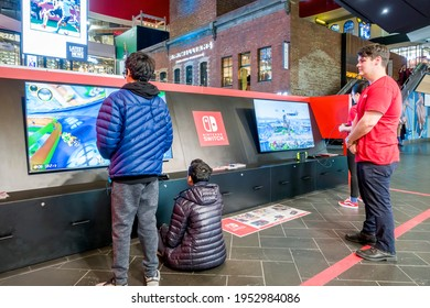 Melbourne, Australia - May 16, 2019: Youngsters testing out games at the Nintendo Switch booth in the Melbourne Central Shopping Mall. An attendant watches. In the Central Business District (CBD).