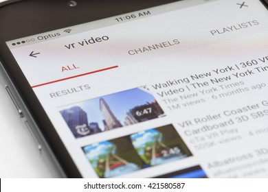 Melbourne, Australia - May 17, 2016: Close-up view of iPhone running newly updated YouTube app with a list of VR videos. This update allows users to watch videos in VR with Google Cardboard