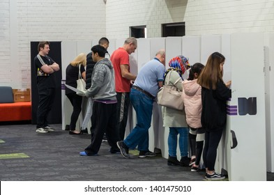 Melbourne, Australia - May 18, 2019: voters in the electorate of Menzies at the 2019 federal election. This polling booth is at East Doncaster Secondary College.