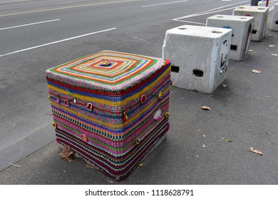 MELBOURNE, AUSTRALIA, May 25, 2018: a concrete cube in Melbourne, Victoria, is decorated with a crocheted cover