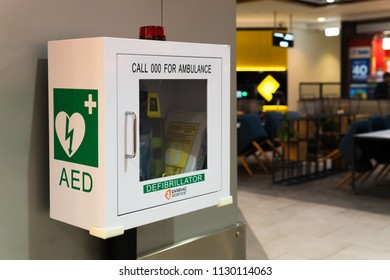 Melbourne, Australia - May 25, 2018: AED heart difibrilator in shopping center. Emergency life saving equipment.
