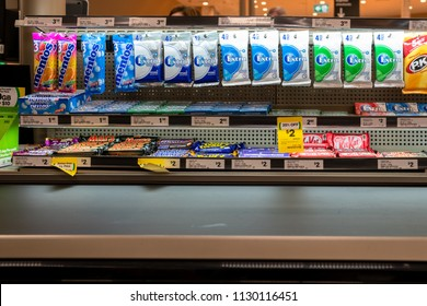 Melbourne, Australia - May 25, 2018: Snack foods displayed near the checkout counter.