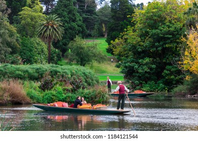 Melbourne, Australia - May 5, 2018: Gondola and tourists on the ornamental lake in the Royal Botanic Gardens. The Royal Botanic Gardens were founded in 1846.