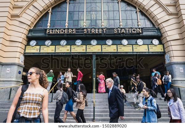 Melbourne, Australia - Nov 10, 2018 : People waliking around Flinders Street railway station is landmark in the downtown of Melbourne, Australia on November 10, 2018.