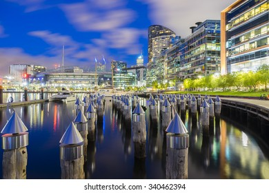 Melbourne, Australia - November 13, 2015: View of bollards, modern buildings, apartments and Etihad Stadium in Victoria Harbour Promenade in Docklands, Melbourne at night.