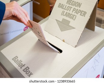 Melbourne, Australia - November 19, 2018: Woman casting her vote in the 2018 Victorian state election, at Antonio Park Primary School in Mitcham.