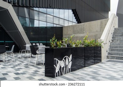 MELBOURNE, AUSTRALIA - November 2, 2014: outdoor cafe at the Deakin University Burwood campus, featuring long tables for students to sit at.
