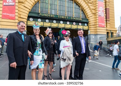 Melbourne, Australia - November 3, 2015: elegantly dressed racegoers in front of Flinders Street Station on Melbourne Cup Day public holiday, returning from Flemington Racecourse.