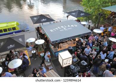 MELBOURNE AUSTRALIA - NOVEMBER 30, 2018: Unidentified people dine at Riverland waterfront pub in Melbourne Australia